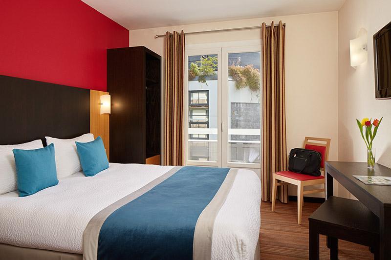 Hotel Lourdes Comfort met een groot bed